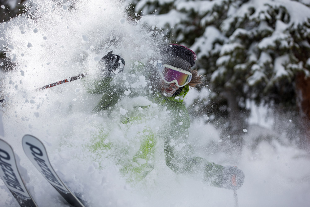 skier going through powder